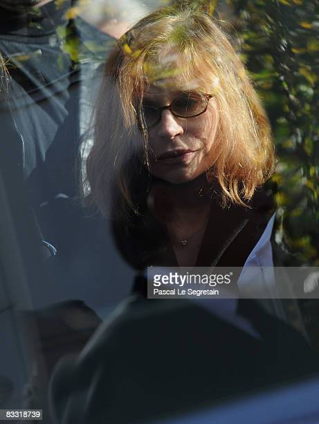 Elisabeth Depardieu prays on the coffin of her son Guillaume Depardieu during the funeral service at Notre-Dame Church on October 17, 2008 in...