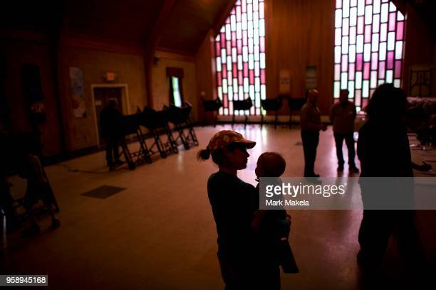 Elisabeth Ford with son Harrison 8 months waits in line to cast her vote at the Trucksville United Methodist Church polling station during the 2018...