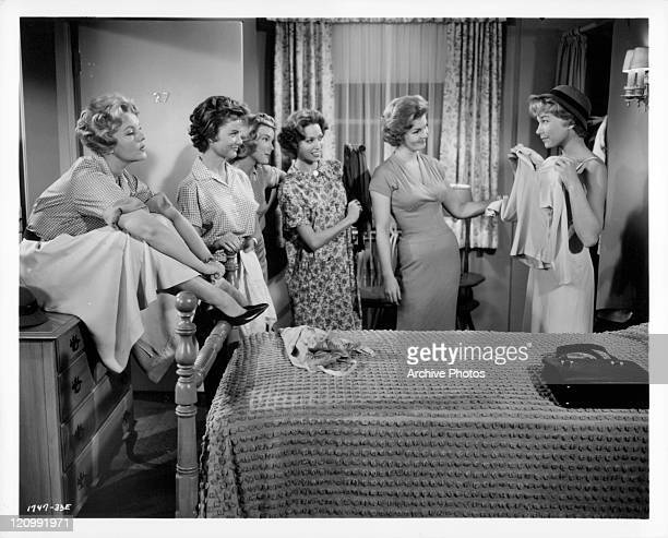 Elisabeth Fraser Dody Heath Carrol Byron Norma French Claire Kelly and Shirley MacLaine in bedroom together listining to Shirley in a scene from the...