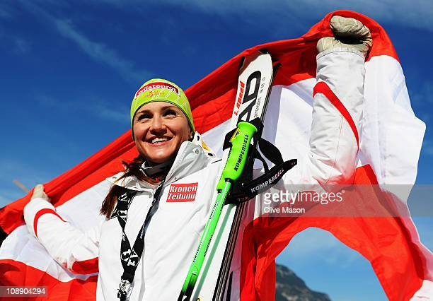 Elisabeth Goergl of Austria celebrates at the flower ceremony after finishing first while competing in the Women's Super G during the Alpine FIS Ski...
