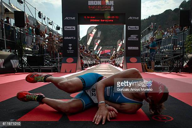 Elisabeth Gruber from Austria falls as she arrives at the finish line on second women's place of the Ironman Barcelona on October 2 2016 in Calella...