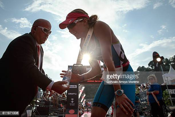Elisabeth Gruber from Austria rests after arriving at the finish line on second women's place of the Ironman Barcelona on October 2 2016 in Calella...