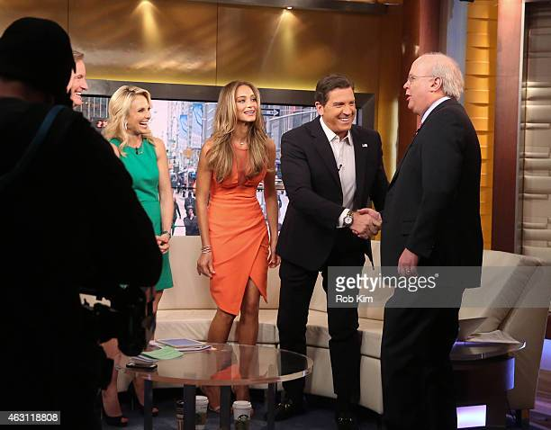 Elisabeth Hasselbeck Hannah Davis and Eric Bolling greet Karl Rove on the set of 'FOX and Friends' at FOX Studios on February 10 2015 in New York City
