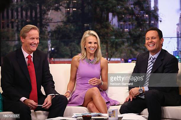 Elisabeth Hasselbeck Joins FOX Friends hosts Steve Doocy and Brian Kilmeade at FOX Studios on September 16 2013 in New York City