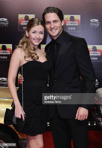 Elisabeth Huebert and Alexander Klaws arrive for the 'Hinterm Horizont' musical premiere at Theater am Potsdamer Platz on January 13 2011 in Berlin...