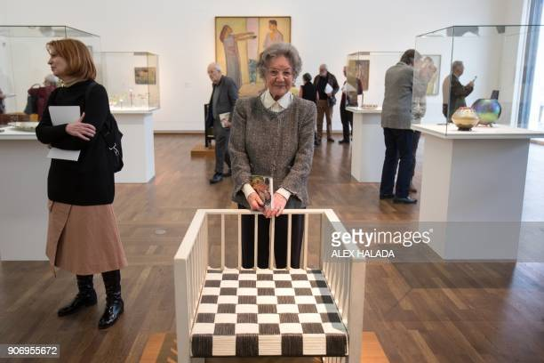 Elisabeth Leopold the widow of art collector and creator of the Leopold Museum Rudolf Leopold poses behind the Purkersdorf Sanatorium's armchair by...