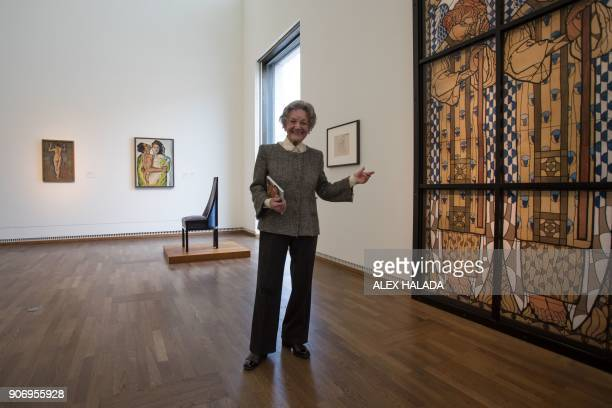Elisabeth Leopold the widow of art collector and creator of the Leopold Museum Rudolf Leopold poses next to an art piece by Austrian artist Koloman...