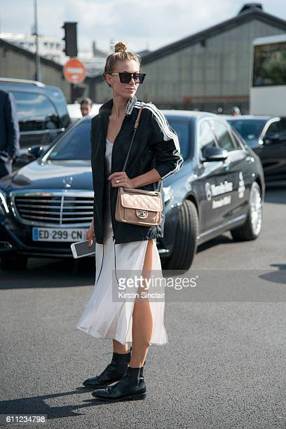 Elisabeth Minett wears a Chanel bag Adidas jacket Saint Laurent shoes Unique design milano sunglasses on day 2 of Paris Womens Fashion Week...