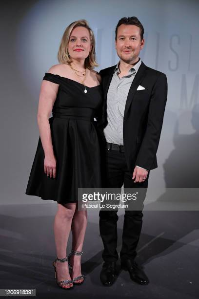 Elisabeth Moss and Leigh Whannell attend the Invisible Man premiere at Gaumont Champs Elysees on February 17 2020 in Paris France