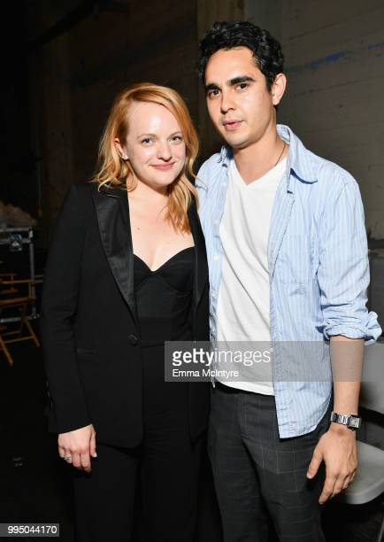 Elisabeth Moss and Max Minghella attend 'The Handmaid's Tale' Hulu finale at The Wilshire Ebell Theatre on July 9 2018 in Los Angeles California