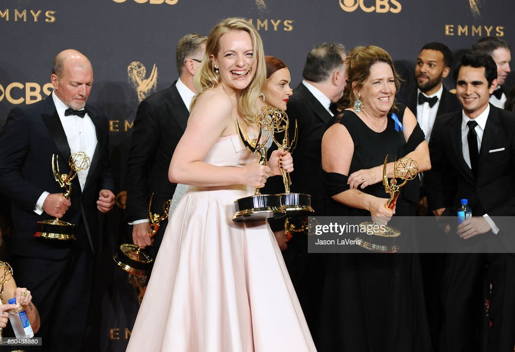 Elisabeth Moss and the cast and crew of The Handmaid's Tale pose in the press room at the 69th annual Primetime Emmy Awards at Microsoft Theater on September 17, 2017 in Los Angeles, California.