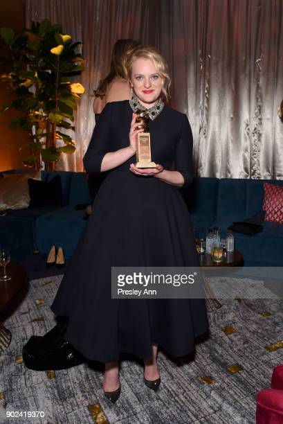 Elisabeth Moss poses with her Best Actress in a Drama TV Series Golden Globe during FOX FX and Hulu 2018 Golden Globe Awards After Party at The...