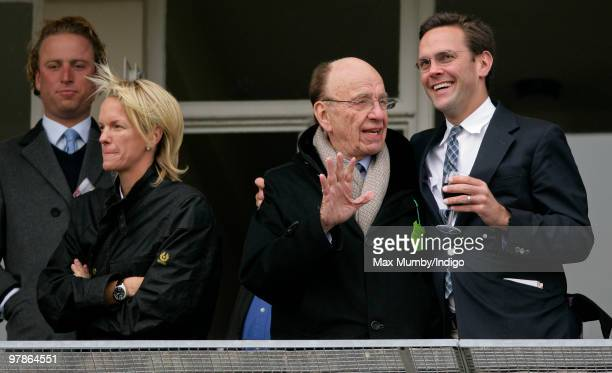 Elisabeth Murdoch Rupert Murdoch and James Murdoch watch the racing as they attend day 3 of the Cheltenham Horse Racing Festival on March 18 2010 in...