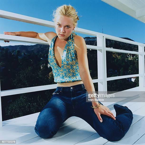 Elisabeth Rohm Kneeling on Balcony