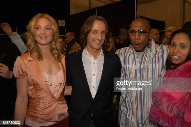 Elisabeth Rohm Luca Orlandi JaRule and Aisha Atkins attend the Luca Luca Fashion Show at The Tent Bryant Park on February 8 2004 in New York City