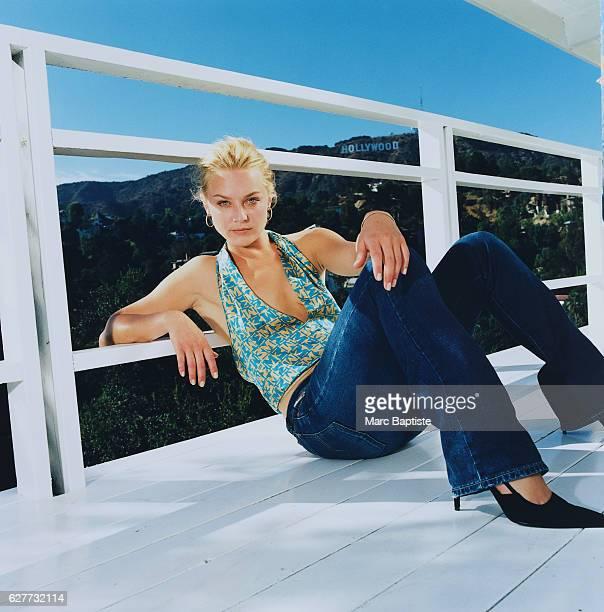 Elisabeth Rohm Reclining on Balcony