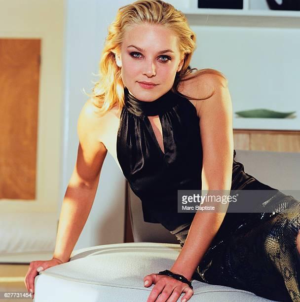 Elisabeth Rohm Seated on a Stool