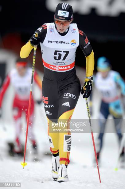 Elisabeth Schicho of Germany competes in the Women's 9km Classic Pursuit at the FIS Cross Country World Cup event at DKB Ski Arena on December 30...