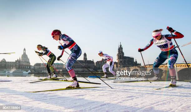 Elisabeth Schicho of team Germany II Sophie Caldwell of team USA I Sylwia Jaskowiec of team Poland and Kikkan Randall of team USA II compete in the...