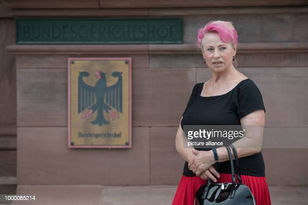 Elisabeth Schmitt who pressed a damages claim against the TUVRheinland concerning substandard breast implants made of industrial silicon standing in...