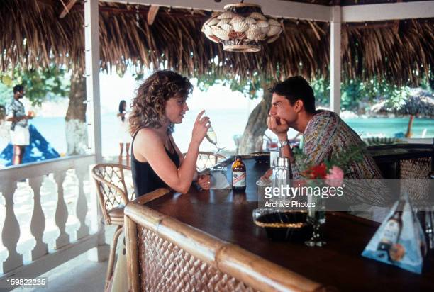 Elisabeth Shue visits Tom Cruise as he bartends in a scene from the film 'Cocktail', 1988.