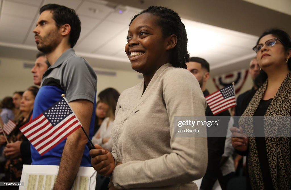 Elisabeth Volmar, orginally from Haiti, becomes an American citizen during a U.S. Citizenship & Immigration Services naturalization ceremony at the Hialeah Field Office on January 12, 2018 in Hialeah, Florida. 150 people from different countries around the world took part in the Oath of Allegiance.