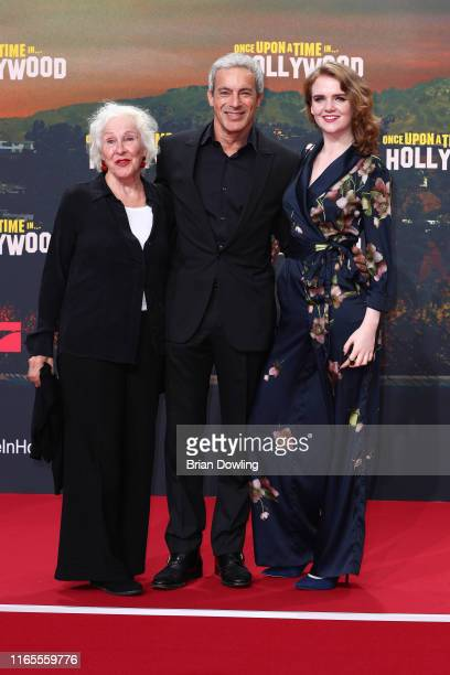 """Elisabeth von Molo, Gedeon Burkhard and Mary Ellen attend the premiere of """"Once Upon A Time... In Hollywood"""" at CineStar on August 01, 2019 in..."""