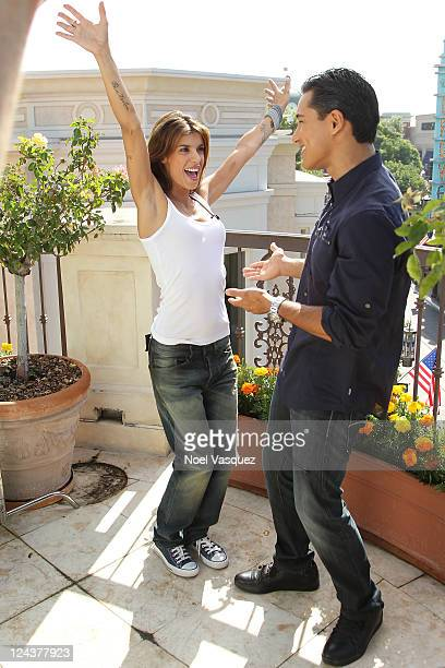 Elisabetta Canalis and Mario Lopez dance together at Extra at The Grove on September 9 2011 in Los Angeles California