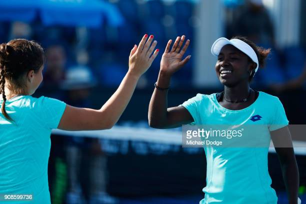 Elisabetta Cocciaretto of Italy and Sada Nahimana of Burundi celebrate winning a point in their girl's doubles match against Anri Nagata of Japan and...