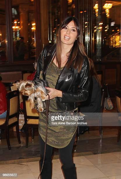 Elisabetta Gregoraci and her dogs pose at Hotel de Paris on April 24, 2010 in Monte-Carlo, Monaco.