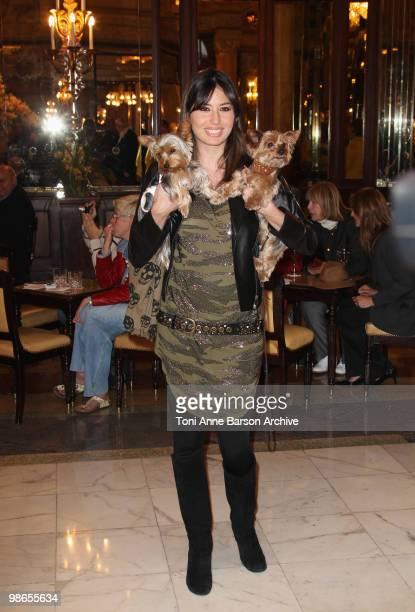 Elisabetta Gregoraci and her dogs pose at Hotel de Paris on April 24 2010 in MonteCarlo Monaco