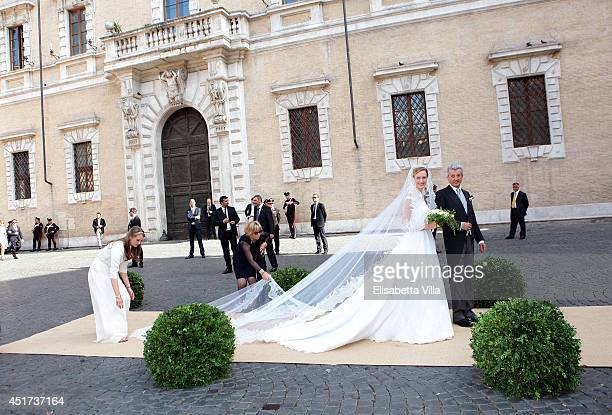 Elisabetta Maria Rosboch von Wolkenstein and her father Ettore Rosboch von Wolkenstein arrive for her wedding to Prince Amedeo of Belgium at Basilica...