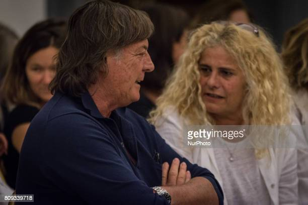 Elisabetta VillaggioAdriano Panatta pay their respects to the late Italian actor inside the City Hall in Rome layinginstate inside the City Hall in...