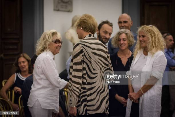 Elisabetta VillaggioMaura AlbitesPierfrancesco VillaggioRoberta Pinotti pay their respects to the late Italian actor inside the City Hall in Rome...