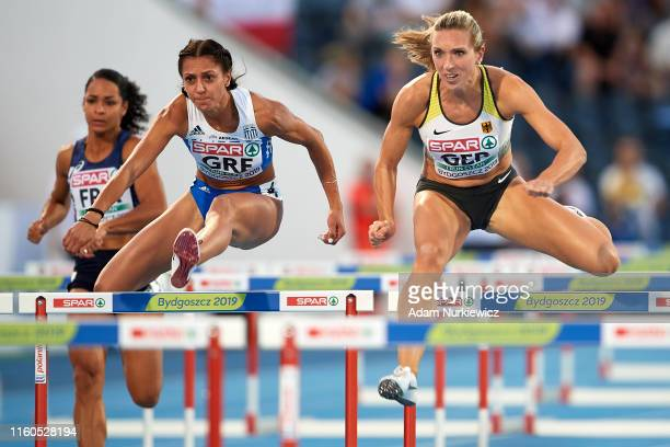 Elisavet Pesiridou from Greece and Cindy Roleder from Germany compete in womens 100 meters hurdles while European Athletics Team Championships Super...