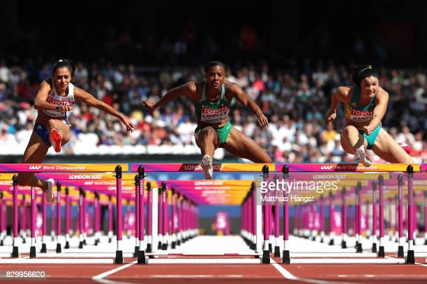 Elisavet Pesiridou of Greece Lindsay Lindley of Nigeria and Michelle Jenneke of Australiacompete in the Women's 100 metres hurdles heats during day...