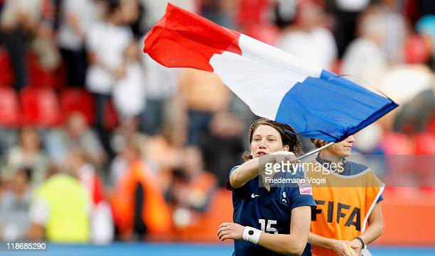 Elise Bussaglia of France celebrates and waves the national flag after winning the FIFA Women's World Cup 2011 Quarter Final match between England...