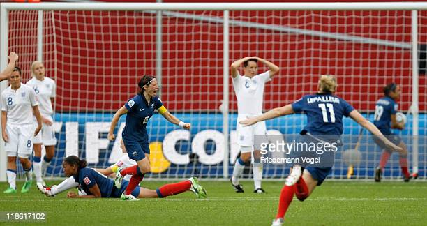 Elise Bussaglia of France celebrates scoring the equalising goal during the FIFA Women's World Cup 2011 Quarter Final match between England and...