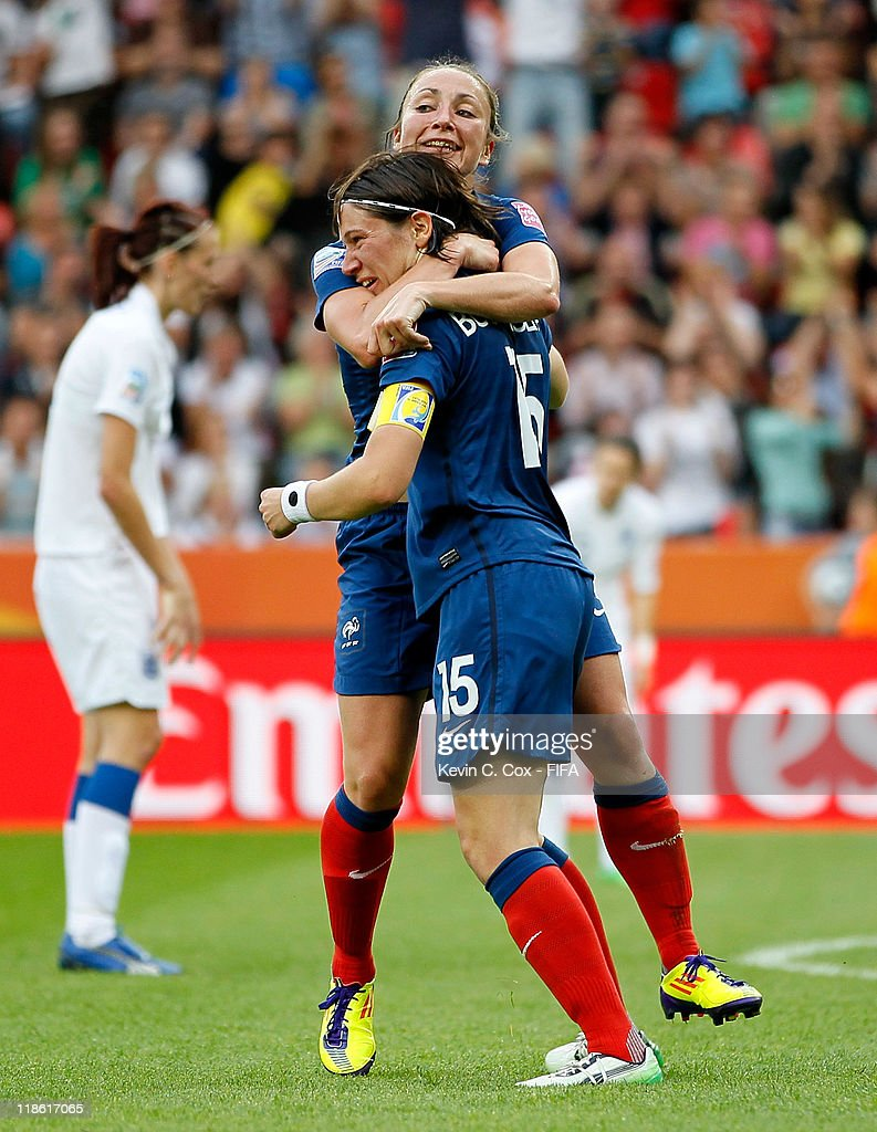 Elise Bussaglia of France celebrates with Gaetane Thiney after Bussaglia scored the equalizer against England during the FIFA Women's World Cup 2011 Quarter Final match between England and France at the FIFA Women's World Cup Stadium Leverkusen on July 9, 2011 in Leverkusen, Germany.