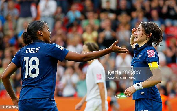 Elise Bussaglia of France celebrates with Marie-Laure Delie after Bussaglia scored the equalizer against England during the FIFA Women's World Cup...