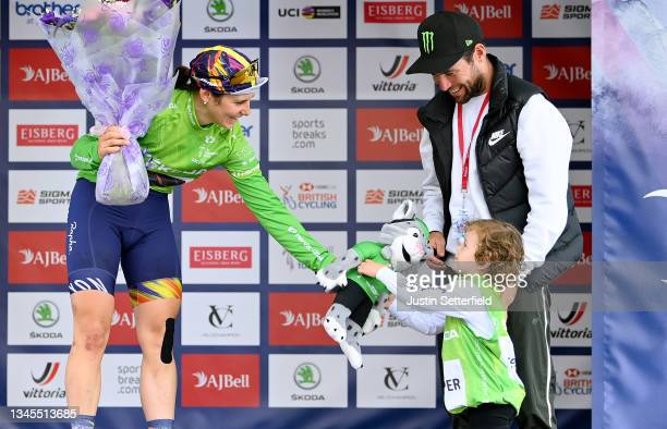 Elise Chabbey of Switzerland and Team Canyon SRAM Racing celebrates winning the Green Queen of the mountains jersey accompanied by Mark Cavendish of...