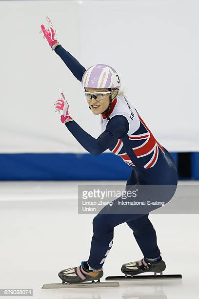 Elise Christie of Britain celebrates after winning the Women's 500m final at the ISU World Cup Short Track speed skating event at the Oriental Sports...