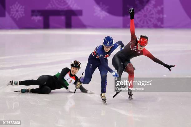 Elise Christie of Great Britain and Kim Boutin of Canada collide as Andrea Keszler of Hungary falls during the Ladies' 500m Short Track Speed Skating...