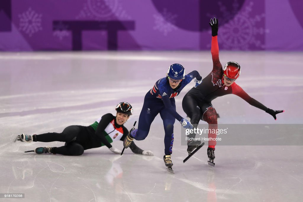 Elise Christie of Great Britain and Kim Boutin of Canada collide as Andrea Keszler of Hungary falls during the Ladies' 500m Short Track Speed Skating quarterfinal day four of the PyeongChang 2018 Winter Olympic Games at Gangneung Ice Arena on February 13, 2018 in Gangneung, South Korea.