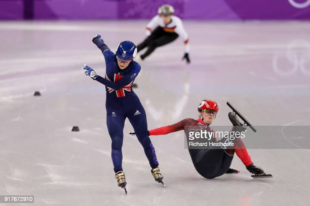 Elise Christie of Great Britain and Kim Boutin of Canada collide during the Ladies' 500m Short Track Speed Skating quarterfinal on day four of the...