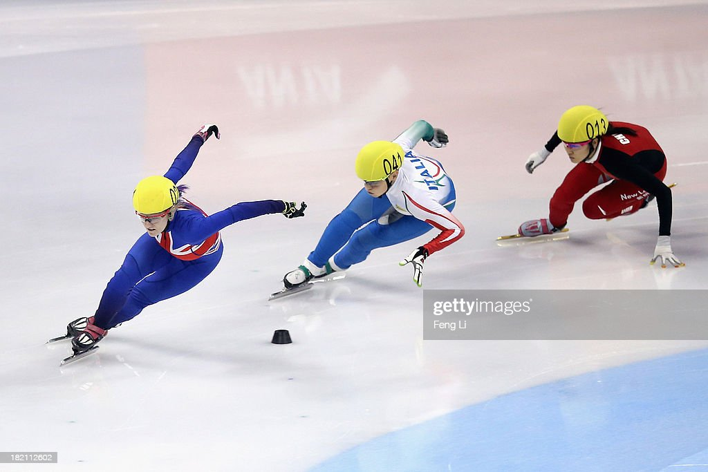 Elise Christie of Great Britain, Arianna Fontana of Italy and Liu Qiuhong of China compete in the Women's 500m Final during day three of the Samsung ISU World Cup Short Track at the Oriental Sports Center on September 28, 2013 in Shanghai, China.