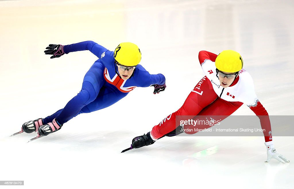 Elise Christie of Great Britain (L) attempts to get past #18 Marianne St-Gelais of Canada (R) during the quarter-finals of the Women's 1000m race on day 1 of the ISU World Cup Short Track Speed Skating on February 7, 2015 in Dresden, Germany.