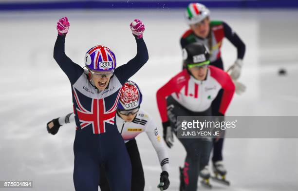 Elise Christie of Great Britain celebrates her victory during the women's 500m final event at the ISU World Cup Short Track Speed Skating in Seoul on...
