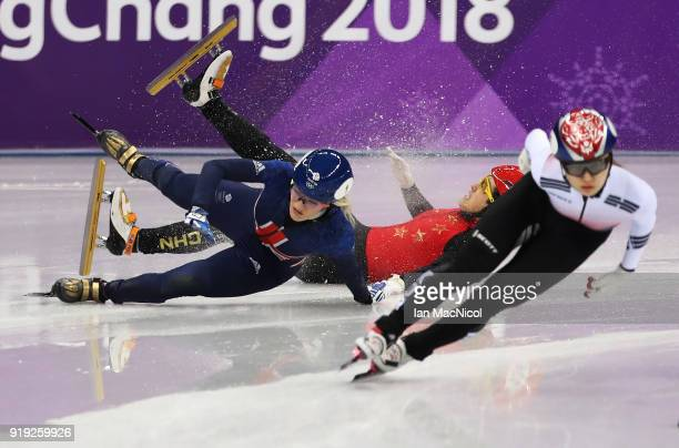 Elise Christie of Great Britain collides with Yang Zhou of China in the semi final of the Women's1500m during the Short Track Speed Skating on day...