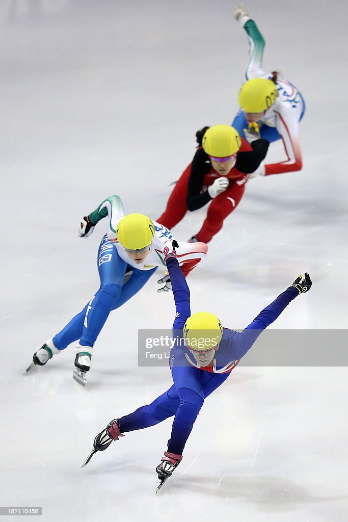 Elise Christie of Great Britain (Front) compete in the Women's 500m Final during day three of the Samsung ISU World Cup Short Track at the Oriental Sports Center on September 28, 2013 in Shanghai, China.